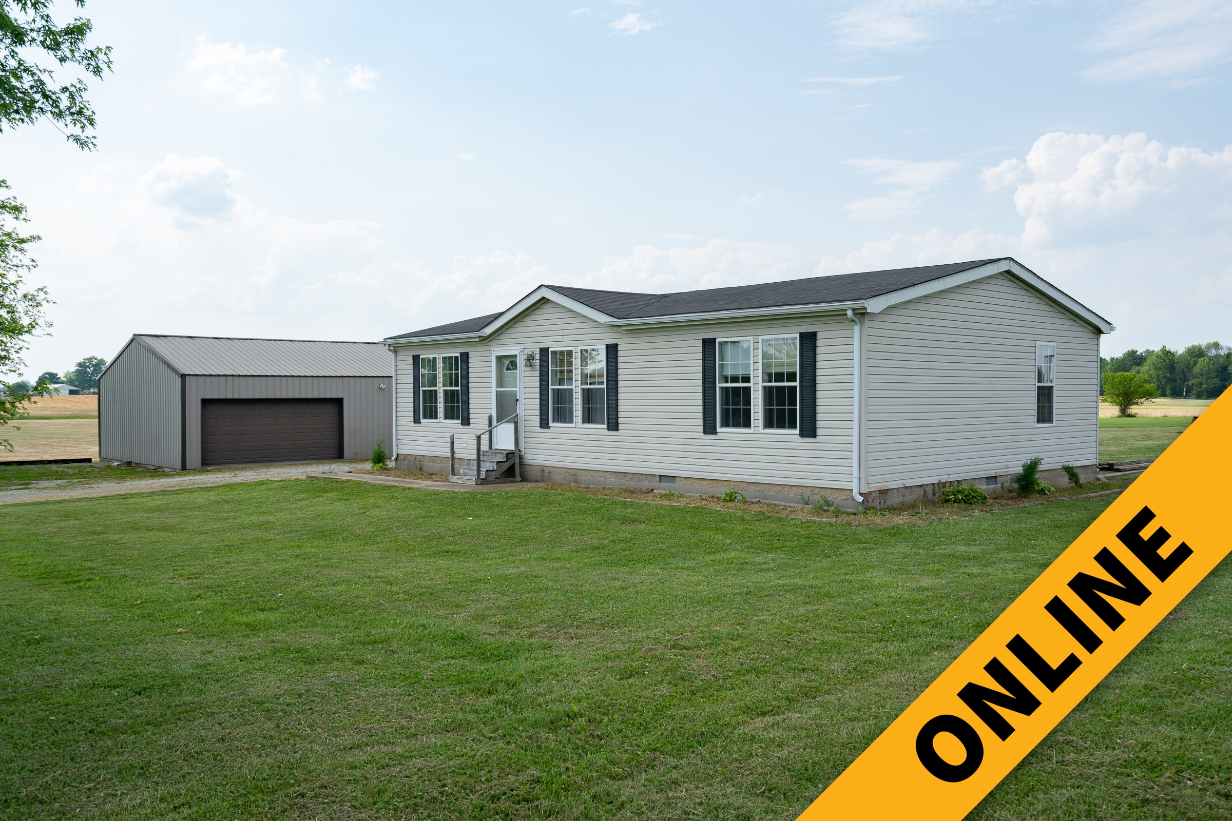Home & Garage On 1.3 Acres Online Auction